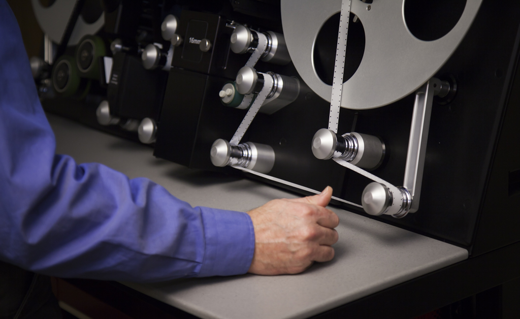 Engineer Boyd Hillestad operates the Lasergraphics ScanStation film scanner.