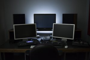An advanced editing suite, with editing, scopes, and color reference monitors, as well as speakers and control surfaces.