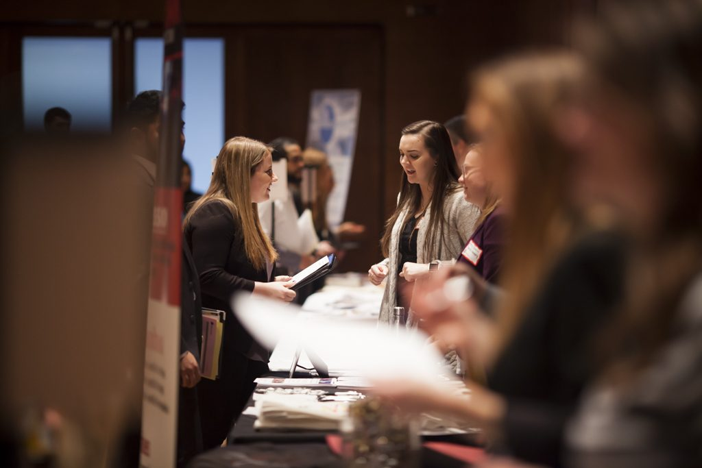 Undergraduate students meet with local businesses in Union South.