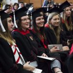 Comm Arts graduates in caps and gowns attend the 2019 Communication Arts Graduation